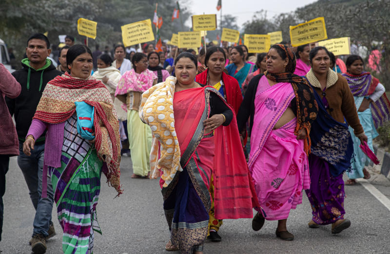 Activists of India's ruling Bharatiya Janata Party (BJP) participate in a procession urging for peace after violence broke out in several parts of the country during protests against the Citizenship Amendment Act, in Nalbari, India, Friday, Dec. 20, 2019. Police banned public gatherings in parts of the Indian capital and other cities for a third day Friday and cut internet services to try to stop growing protests against a new citizenship law that have left 11 people dead and more than 4,000 others detained. (AP Photo/Anupam Nath)