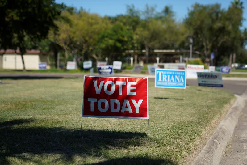 A voting sign is seen outside of a polling site in McAllen
