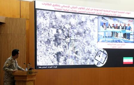 Official spokesperson for the Saudi-led coalition fighting in Yemen, Colonel Turki Al-Malik, displays on a screen a satellite image shows an drone strike during a news conference, in Riyadh