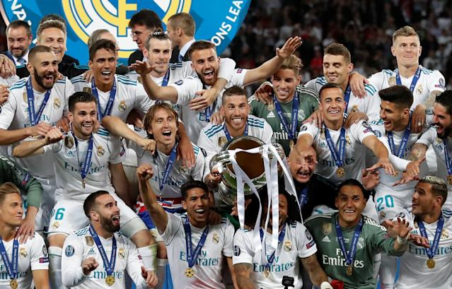 Soccer Football - Champions League Final - Real Madrid v Liverpool - NSC Olympic Stadium, Kiev, Ukraine - May 26, 2018 Real Madrid's Sergio Ramos lifts the trophy as they celebrate winning the Champions League REUTERS/Andrew Boyers