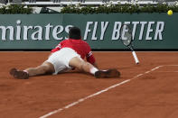 Serbia's Novak Djokovic falls as he plays Italy's Matteo Berrettini in a quarterfinal match of the French Open tennis tournament at the Roland Garros stadium Wednesday, June 9, 2021 in Paris. (AP Photo/Michel Euler)