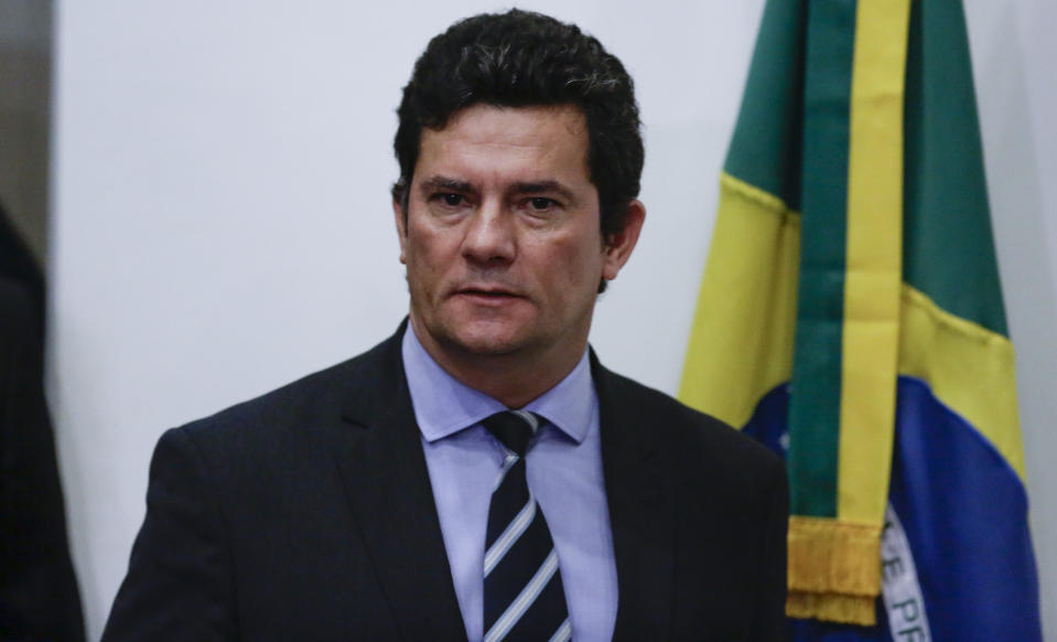 Brazil's Justice Minister Sergio Moro arrives to give a press conference in Brasilia, Brazil, Friday, April 24, 2020. Moro announced his resignation Friday after Brazilian President Jair Bolsonaro changed the head of the country's federal police. (AP Photo/Eraldo Peres)