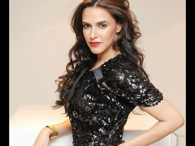 <b>3. Neha Dhupia</b><br>This style diva has always surprised us with her unique looks and innovative attires. She is one actress who never hesitates to look different. Why, for a red carpet eventshe once went completely androgynous and ditched the gown, all the while looking absolutely stunning!
