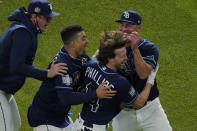 Tampa Bay Rays' Brett Phillips (14) celebrates after getting the game winning hit against the Los Angeles Dodgers in Game 4 of the baseball World Series Saturday, Oct. 24, 2020, in Arlington, Texas. Rays defeated the Dodgers 8-7 to tie the series 2-2 games. (AP Photo/Sue Ogrocki)