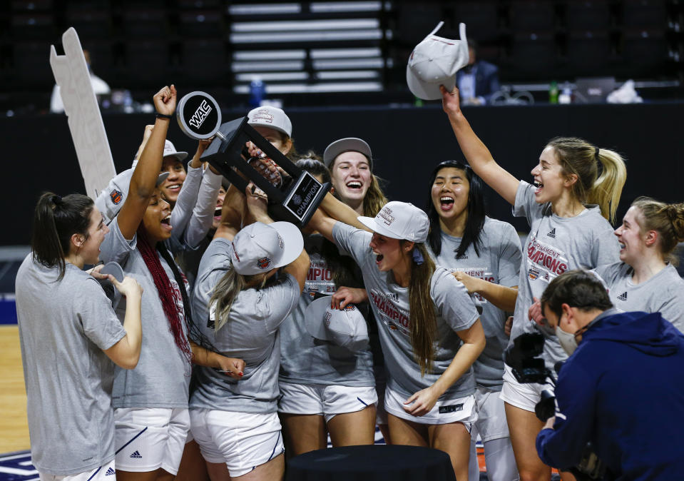 California Baptist players celebrate after defeating Grand Canyon in an NCAA college basketball game for the championship of the Western Athletic Conference women's tournament Saturday, March 13, 2021, in Las Vegas. (AP Photo/Chase Stevens)