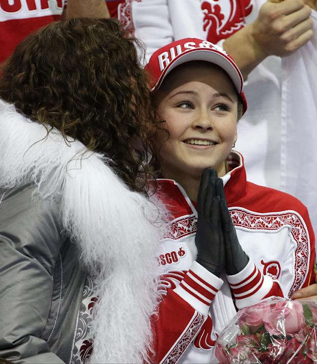 Julia Lipnitskaia of Russia sits in the results area after competing in the women's team free skate figure skating competition at the Iceberg Skating Palace during the 2014 Winter Olympics, Sunday, Feb. 9, 2014, in Sochi, Russia. (AP Photo/David J. Phillip )