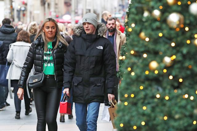 Shoppers in Buchanan Street, Glasgow, on the last Sunday before Christmas. Photo: PA