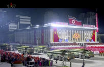 In this image made from video broadcasted by North Korea's KRT, military parade is held to mark the 75th anniversary of the country's ruling party in Pyongyang Saturday, Oct. 10, 2020.(KRT via AP)