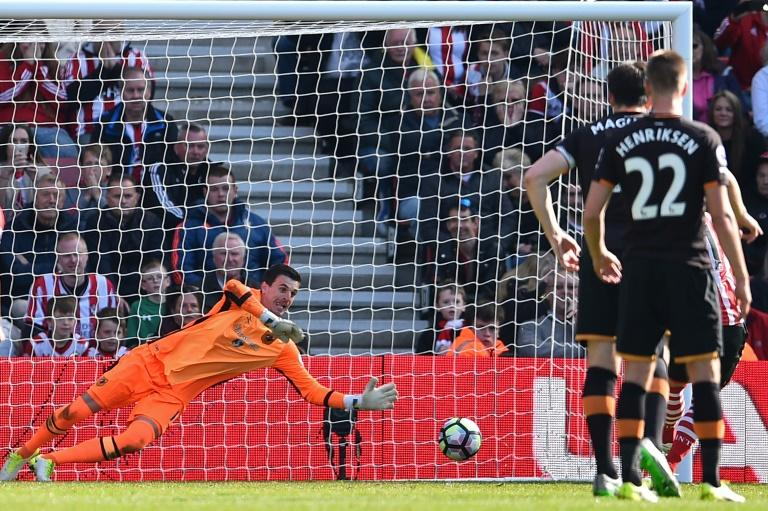 Hull City's Eldin Jakupovic dives to save the penalty kick taken by Southampton's Dusan Tadic during their match at St Mary's Stadium in Southampton, southern England on April 29, 2017