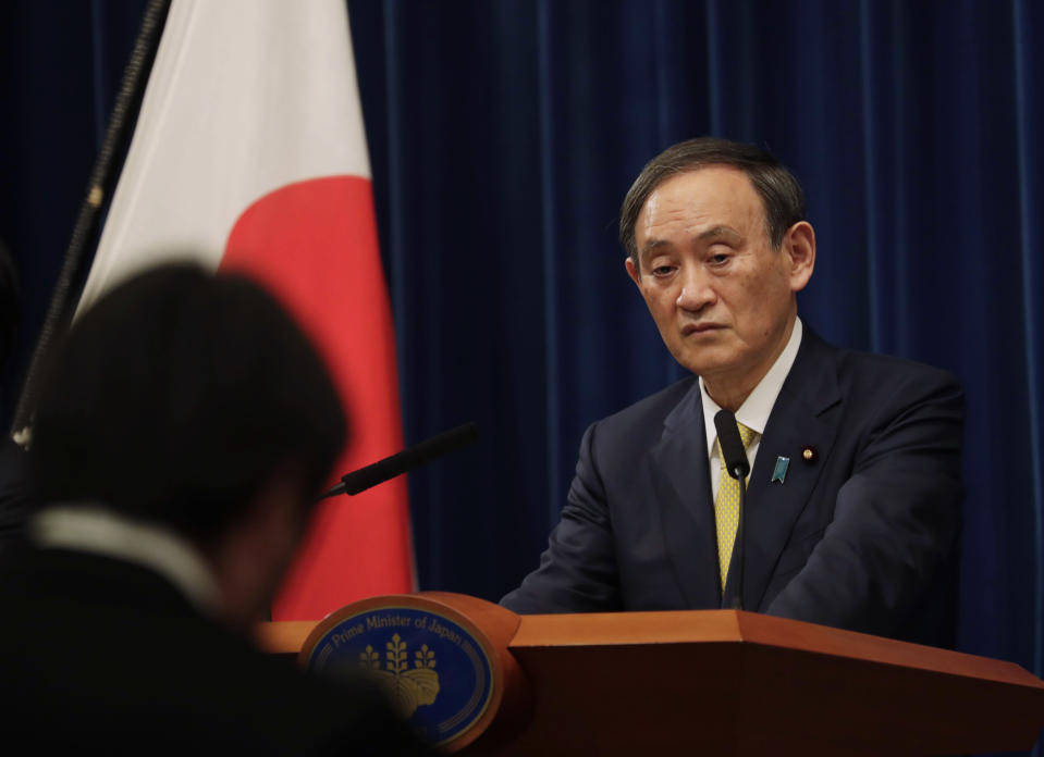 Japanese Prime Minister Yoshihide Suga speaks during a news conference in Tokyo on Friday, Dec. 4, 2020. Suga announced a 2 trillion green fund to promote innovation and technology to achieve his pledge to achieve a carbon free society by 2050.(AP Photo/Hiro Komae, Pool)