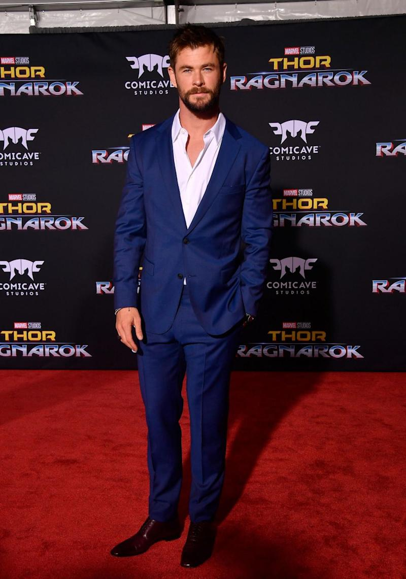 The former Home and Away star oozed sex appeal in a blue suit, and ditched his long Thor locks for a neat, dark hairstyle. Source: Getty