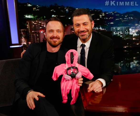 "<p>Aw — a future baby meth maker! Dad-to-be Aaron Paul got a hilarious gift when he visited <i>Jimmy Kimmel Live</i> on Tuesday. The pink, mini-size hazmat suit was of course a nod to <i>The Path</i> star's old show <i>Breaking Bad</i>, which saw his character manufacturing meth. Paul and his wife, Lauren, are expecting their first child any day now. (Photo: <a href=""https://www.instagram.com/p/BeUZEFoBWIt/?hl=en&taken-by=glassofwhiskey"" rel=""nofollow noopener"" target=""_blank"" data-ylk=""slk:Aaron Paul via Instagram"" class=""link rapid-noclick-resp"">Aaron Paul via Instagram</a>) </p>"
