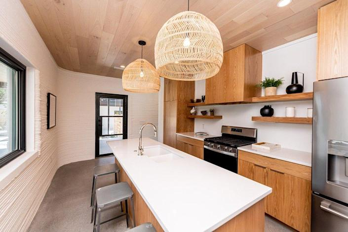 Modern kitchen area inside Logan Architecture and ICON 3D printed homes in Austin.