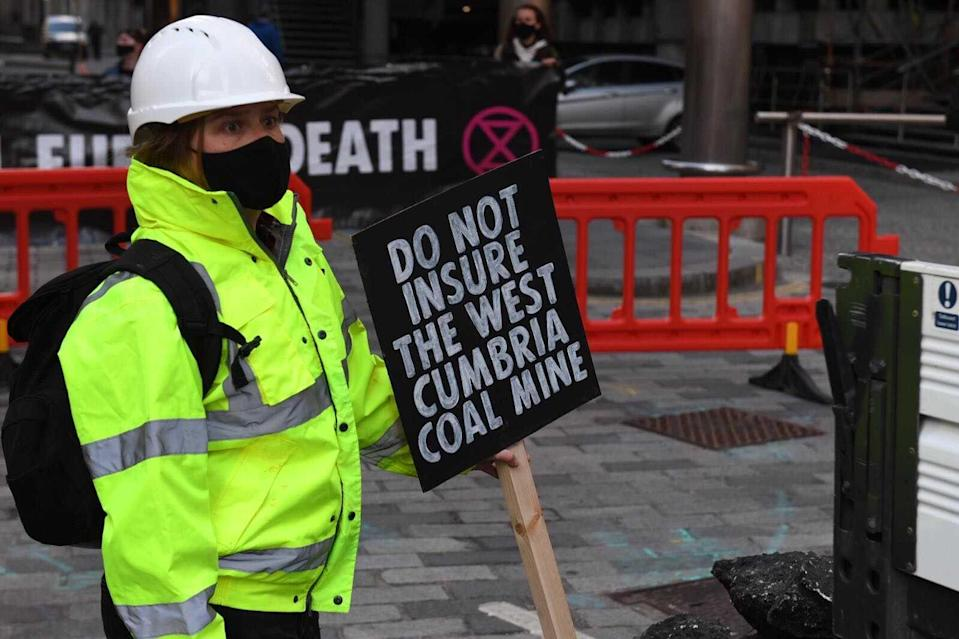 A sign placed in a fake mound of coal reads 'do not insure the west Cumbria coal mineGareth Morris