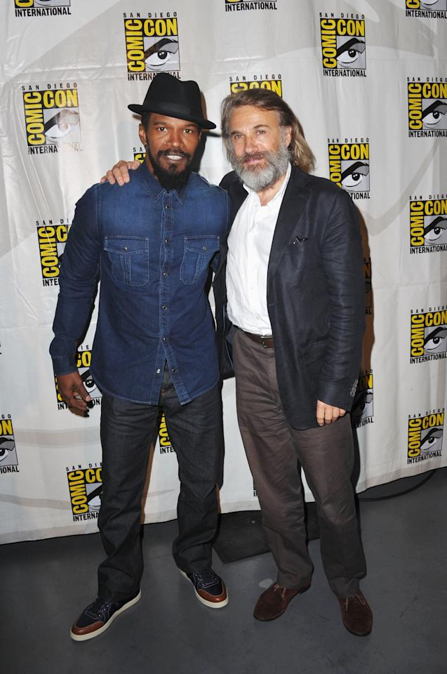 "SAN DIEGO, CA - JULY 14: Actors Jamie Foxx (L) and Christoph Waltz  speak at the ""Django Unchained"" panel during Comic-Con International 2012 at San Diego Convention Center on July 14, 2012 in San Diego, California.  (Photo by Albert L. Ortega/Getty Images)"