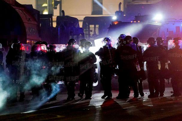 PHOTO: Authorities disperse protesters out of a park Tuesday, Aug. 25, 2020 in Kenosha, Wis. (Morry Gash/AP)