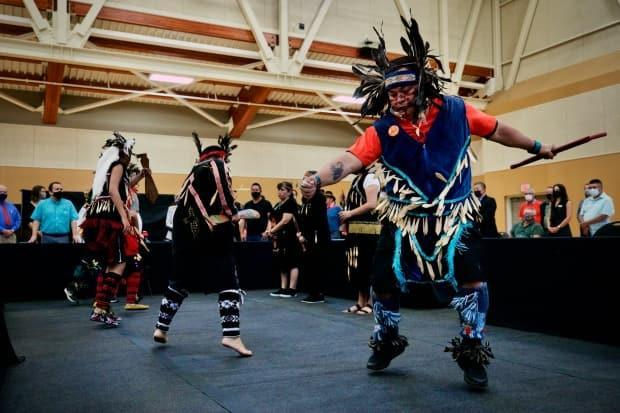 Traditional dancing and singing opened a gathering in Esquimalt Friday morning, where chiefs of First Nations on southern Vancouver Island decried recent acts of vandalism and racism in the capital region. (Michael McArther/CBC - image credit)