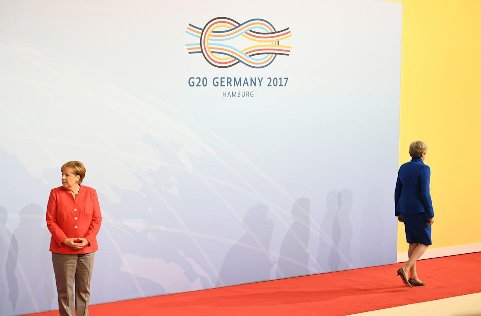 Theresa May and German Chancellor Angela Merkel attending the G20 summit in Hamburg. An indicative picture of the divide between the UK and the rest of the EU. Photo dated 07/07/17 (PA)