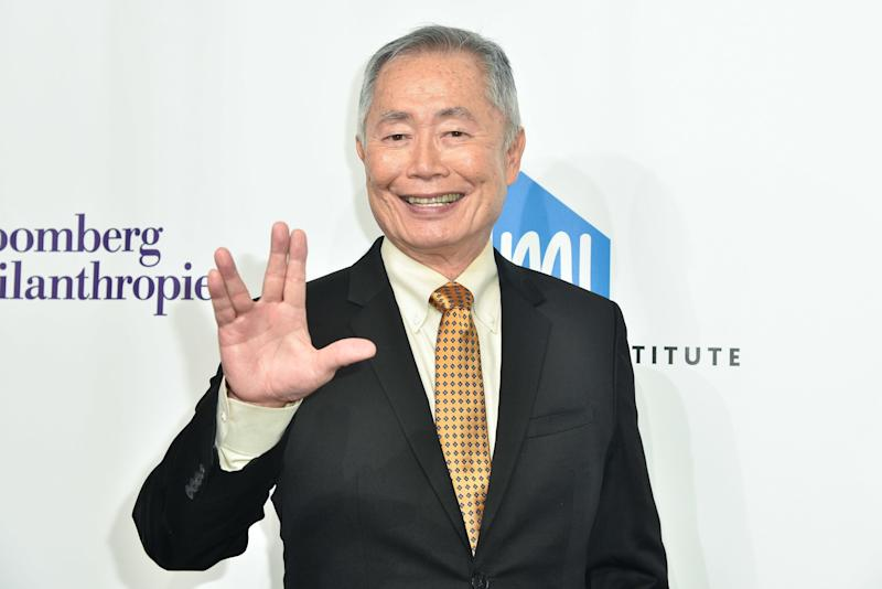 George Takei gives the Vulcan salute on a red carpet in 2016.