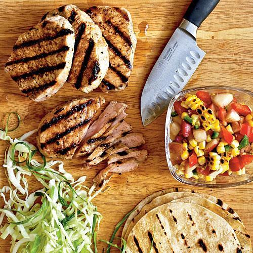 """<p>We love this recipe because it is a complete hand-held meal nestled within a grilled corn tortilla—plus, it's budget-friendly. Be sure to zest your lime before you slice and juice it.</p> <p> <a rel=""""nofollow noopener"""" href=""""http://www.myrecipes.com/recipe/grilled-pork-tacos-with-summer-corn-nectarine-salsa"""" target=""""_blank"""" data-ylk=""""slk:View Recipe: Grilled Pork Tacos with Summer Corn and Nectarine Salsa"""" class=""""link rapid-noclick-resp"""">View Recipe: Grilled Pork Tacos with Summer Corn and Nectarine Salsa</a></p>"""