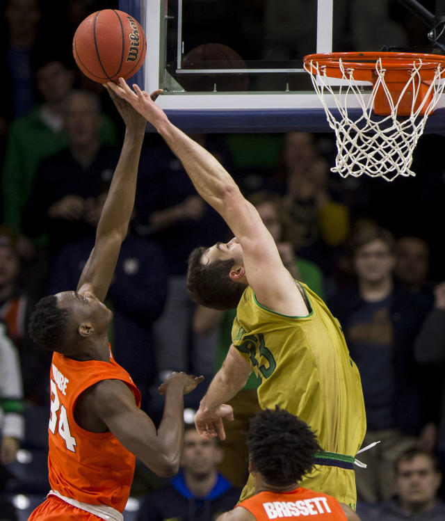 Syracuse's Bourama Sidibe (34) and Notre Dame's John Mooney (33) compete for a rebound during the second half of an NCAA college basketball game Saturday, Jan. 5, 2019, in South Bend, Ind. Syracuse won 72-62. (AP Photo/Robert Franklin)
