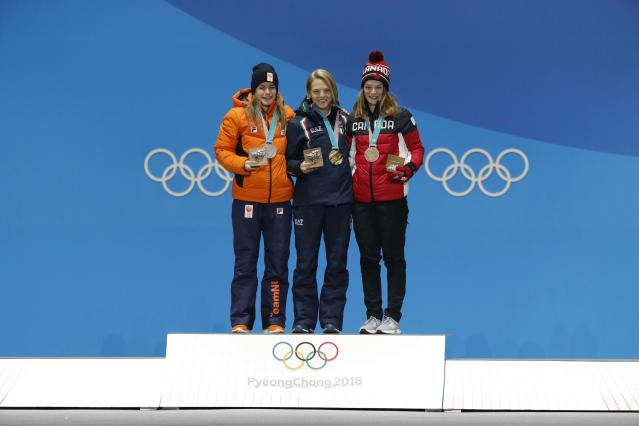 Medals Ceremony - Short Track Speed Skating Events - Pyeongchang 2018 Winter Olympics - Women's 500m - Medals Plaza - Pyeongchang, South Korea - February 14, 2018 - Gold medalist Arianna Fontana of Italy, silver medalist Yara van Kerkhof of the Netherlands and bronze medallst Kim Boutin of Canada on the podium. REUTERS/Eric Gaillard