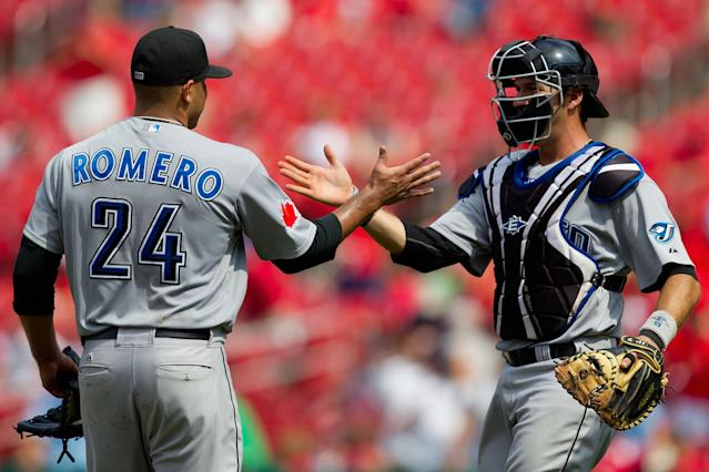 ST. LOUIS, MO - JUNE 26: Starter Ricky Romero #24 and J.P. Arencibia #9 both of the Toronto Blue Jays celebrate a victory against the St. Louis Cardinals at Busch Stadium on June 26, 2011 in St. Louis, Missouri. (Photo by Dilip Vishwanat/Getty Images)