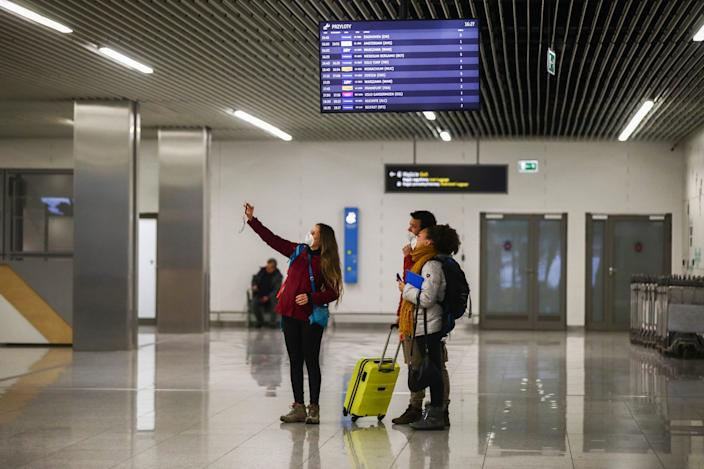 Passengers wearing protective masks arrived in a flight from Milano, Italy to Krakow Airport in Balice, Poland 2