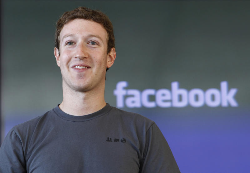 FILE - In this Jan. 3, 2011 file photo, Facebook CEO Mark Zuckerberg smiles in San Francisco. Facebook Inc. CEO Mark Zuckerberg is speaking at a technology conference in San Francisco on Tuesday, Sept. 11, 2012, It is his first interview since the company's rocky initial public offering earlier this year. (AP Photo/Paul Sakuma, File)