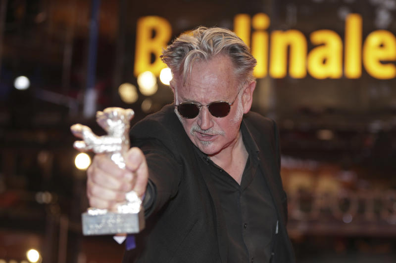 Benoit Delepine holds the Silver Bear 70th Berlinale award for the film 'Delete History' after the award ceremony at the 70th International Berlinale Film Festival in Berlin, Germany. Saturday, Feb. 29, 2020. (AP Photo/Michael Sohn)