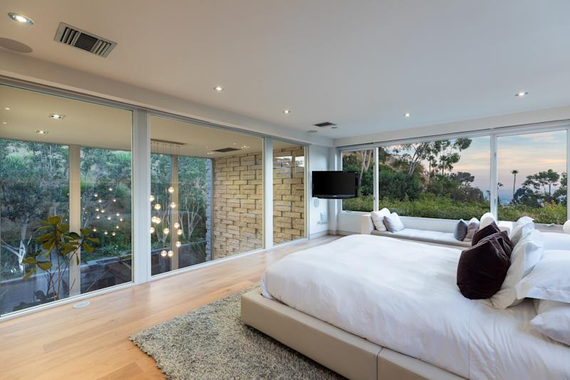The unique master bedroom, which is lined with windows.