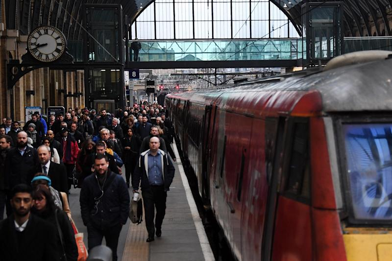 Commuters arrive at King's Cross station in London (EPA)