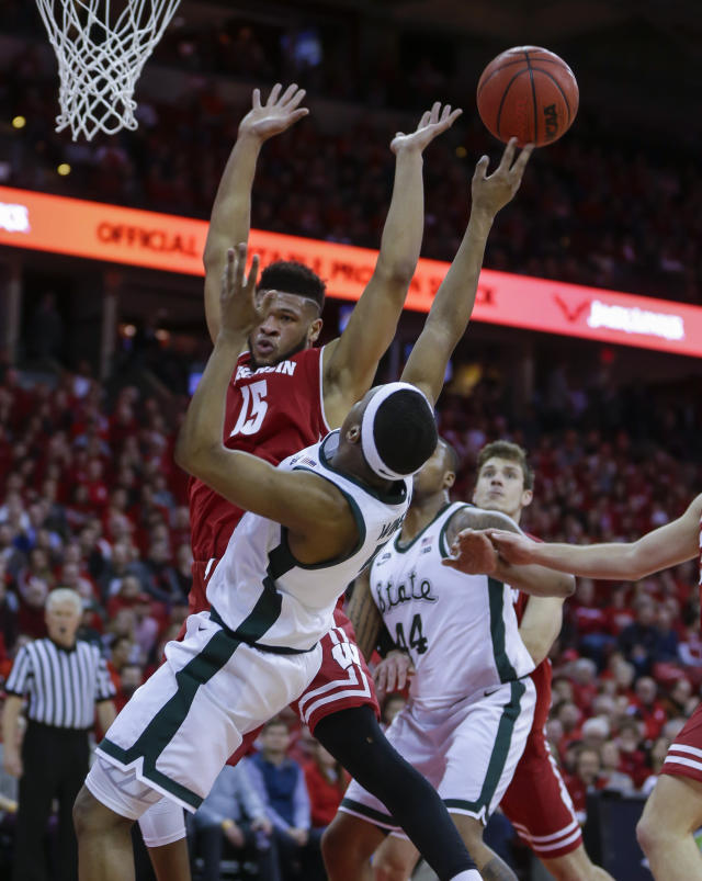 Michigan States's Kyle Ahrens (0) shoots as Wisconsin's Charles Thomas (15) defends during the first half of an NCAA college basketball game Tuesday, Feb. 12, 2019, in Madison, Wis. (AP Photo/Andy Manis)