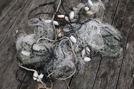 Fishing nets lie at a dock in Wanchese, North Carolina, U.S., May 30 2017. Picture taken May 30, 2017.    REUTERS/Shannon Stapleton