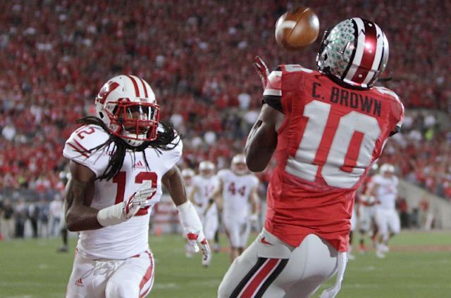 Ohio State wide receiver Corey Brown, catches a touchdown pass as Wisconsin safety Dezmen Southward defends during the second quarter of an NCAA college football game Saturday, Sept. 28, 2013, in Columbus, Ohio. (AP Photo/Jay LaPrete)