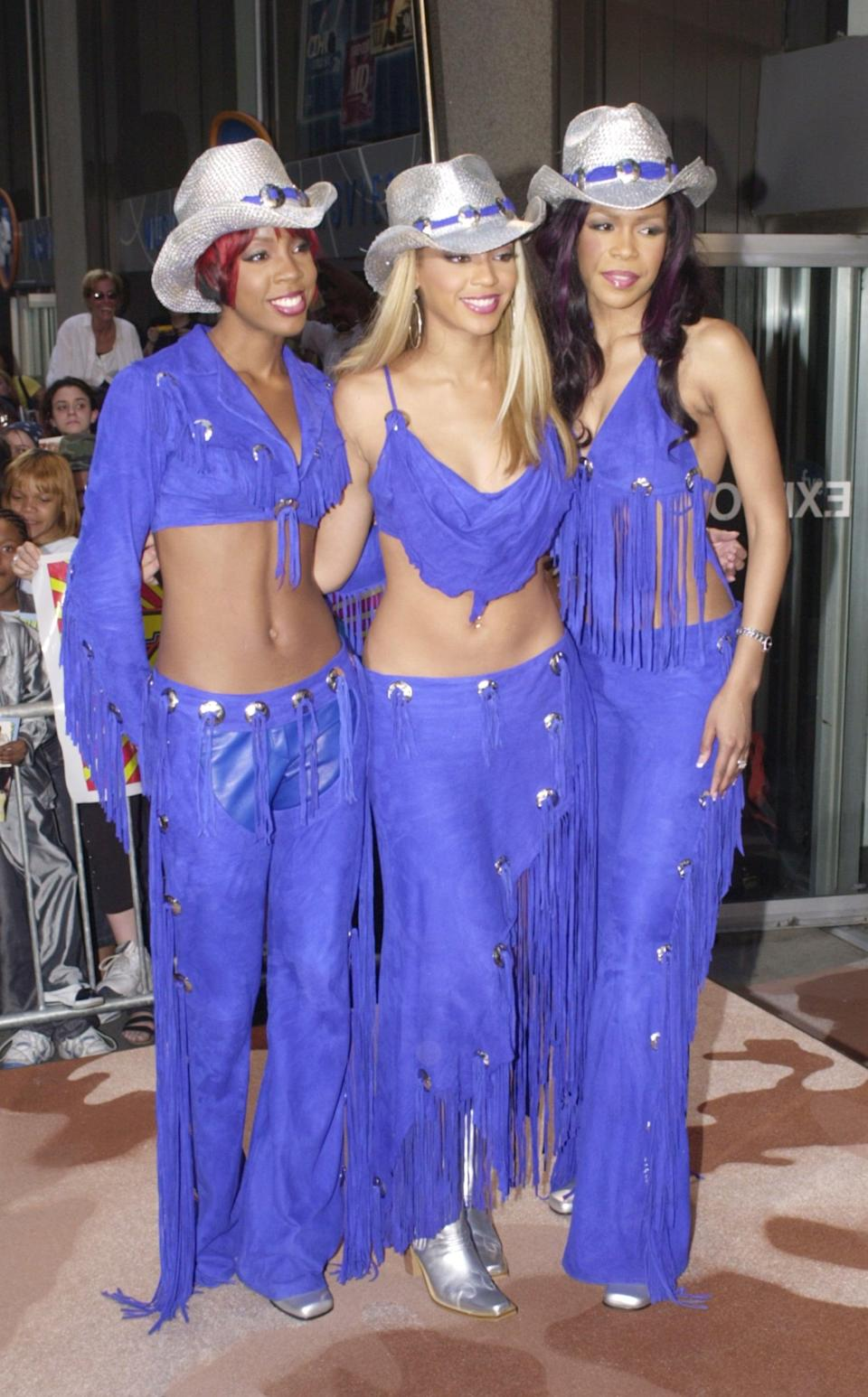 <p>Matching in purple Western looks at their album event in 2001.</p>