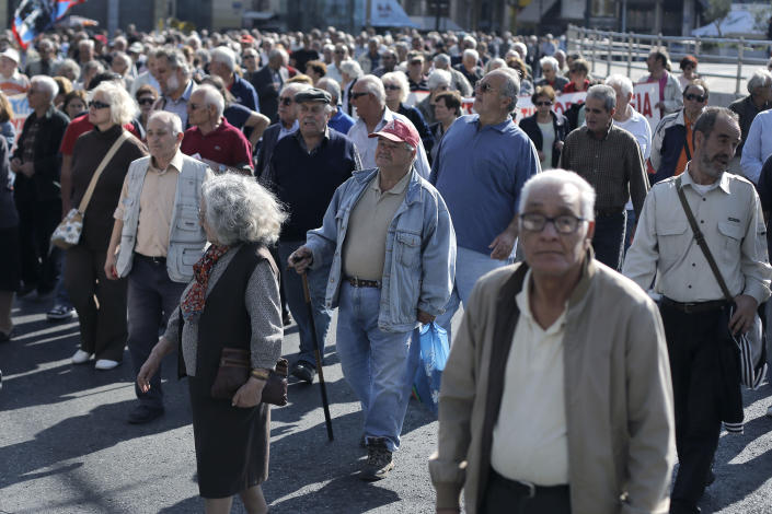 Pensioners take part in a protest against the government austerity measures in central Athens, on Thursday, Oct. 31, 2013. Elderly Greeks have faced successive pension cuts since Greece began relying on international rescue loans in 2010, and have also been hard hit by health care cuts.(AP Photo/Petros Giannakouris)