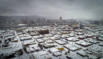 An aerial view of Southeast Portland, Ore., is seen during a snowstorm, on Friday, February 12, 2021. (Brooke Herbert/The Oregonian via AP)