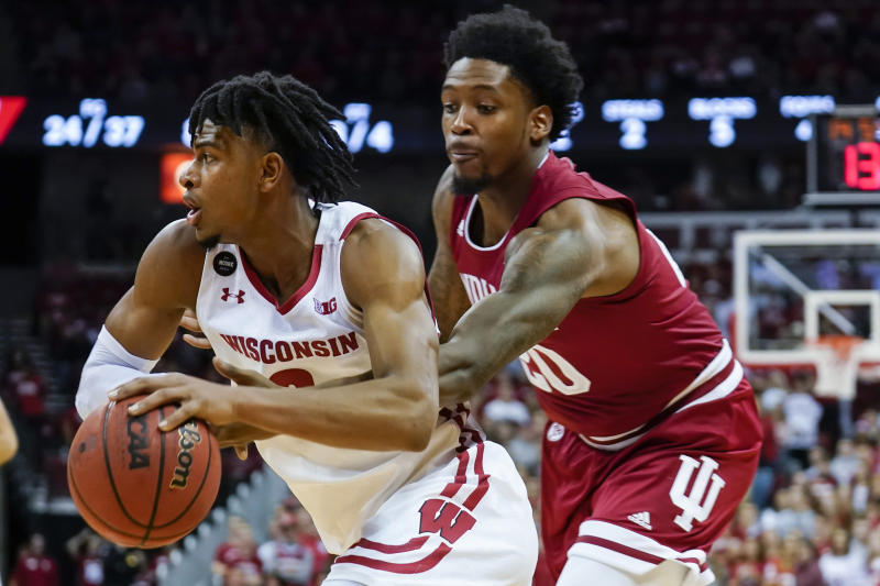 Indiana's De'Ron Davis (20) reaches in on Wisconsin's Aleem Ford (2) during the second half of an NCAA college basketball game Saturday, Dec. 7, 2019, in Madison, Wis. Wisconsin won 84-64. (AP Photo/Andy Manis)