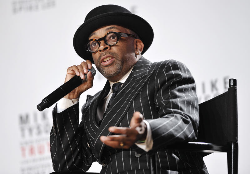 """FILE - This June 18, 2012 file photo shows director Spike Lee talks about his Broadway directorial debut """"Mike Tyson: Undisputed Truth"""", a one man show starring Mike Tyson, in New York. Lee is working on a yet untitled documentary about Michael Jackson's """"Bad"""" album. Lee's documentary will be part a flood of material to celebrate the 25th anniversary of the """"Bad"""" album, Jackson's follow-up to """"Thriller"""" which included hits like the title track, """"Smooth Criminal,"""" """"The Way You Make Me Feel"""" and more. The album is being re-released Sept.18 with additional tracks, a DVD and other bonus material; Lee's film is due to come out later this year, but no date has been set. (Photo by Evan Agostini/Invision/AP, file)"""