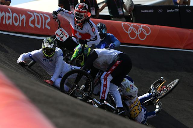 LONDON, ENGLAND - AUGUST 09: Manuel de Vecchi (L) of Italy goes to ground as the pack crash on the berm during the Men's BMX Cycling Quarter Finals on Day 13 of the London 2012 Olympic Games at BMX Track on August 9, 2012 in London, England. (Photo by Phil Walter/Getty Images)