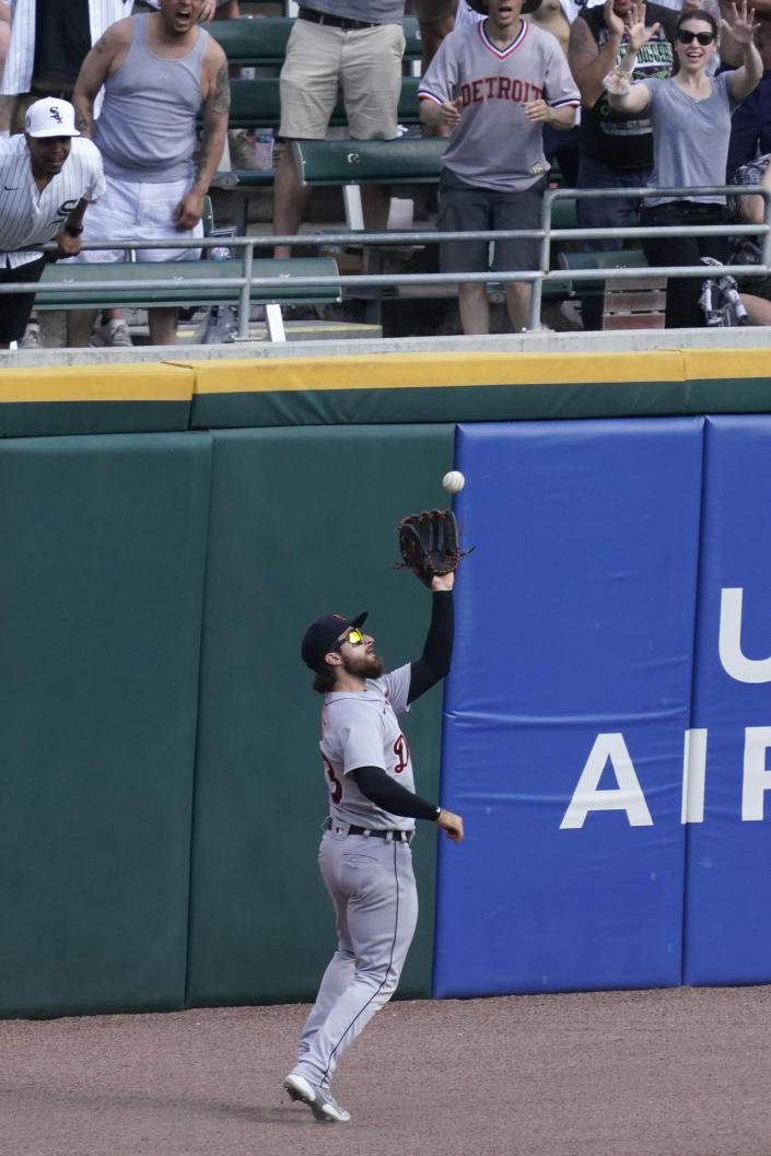 Detroit Tigers left fielder Eric Haase catches a fly ball hit by Chicago White Sox's Yermin Mercedes during the eighth inning of a baseball game in Chicago, Saturday, June 5, 2021. (AP Photo/Nam Y. Huh)