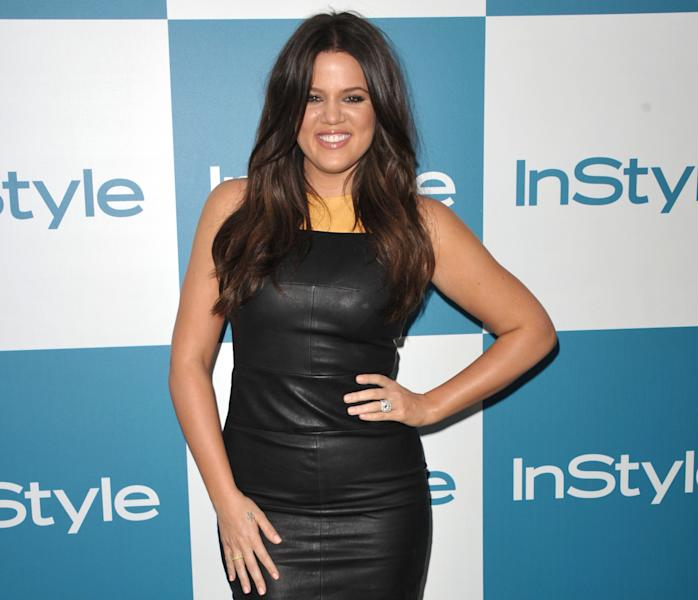 "FILE - In this Aug. 8, 2012 file photo, Khloe Kardashian attends the InStyle Summer Soiree at The London Hotel, in West Hollywood, Calif. Fox's ""The X Factor"" began airing live episodes Wednesday, Oct. 31, 2012, with new co-hosts Khloe Kardashian and Mario Lopez. (Photo by John Shearer/Invision/AP, File)"