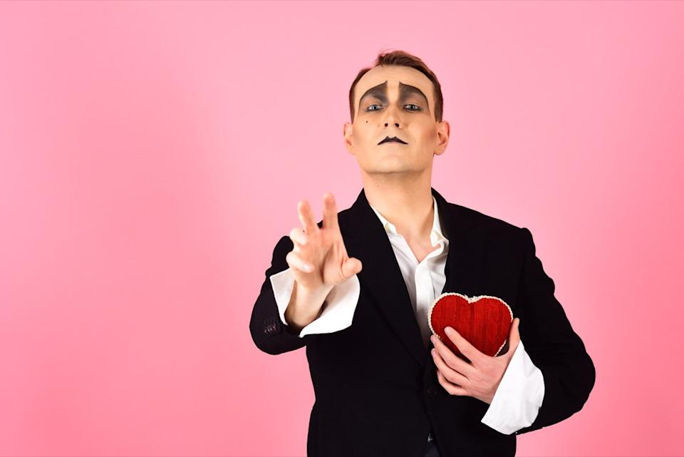 archimime holding a heart