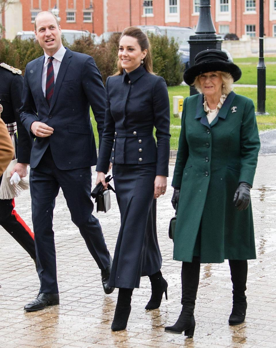 """<p>For <a href=""""https://www.townandcountrymag.com/society/tradition/a30859150/kate-middleton-prince-william-charles-camilla-rare-appearance-military-rehab-leicester/"""" rel=""""nofollow noopener"""" target=""""_blank"""" data-ylk=""""slk:a rare joint engagement"""" class=""""link rapid-noclick-resp"""">a rare joint engagement</a> with Prince Charles, Prince William, and Kate Middleton, Camilla wore a hunter green coat with black, block-heeled boots, and a black furry hat. The group visited a rehabilitation center for members of the armed forces in Leicestershire.</p>"""