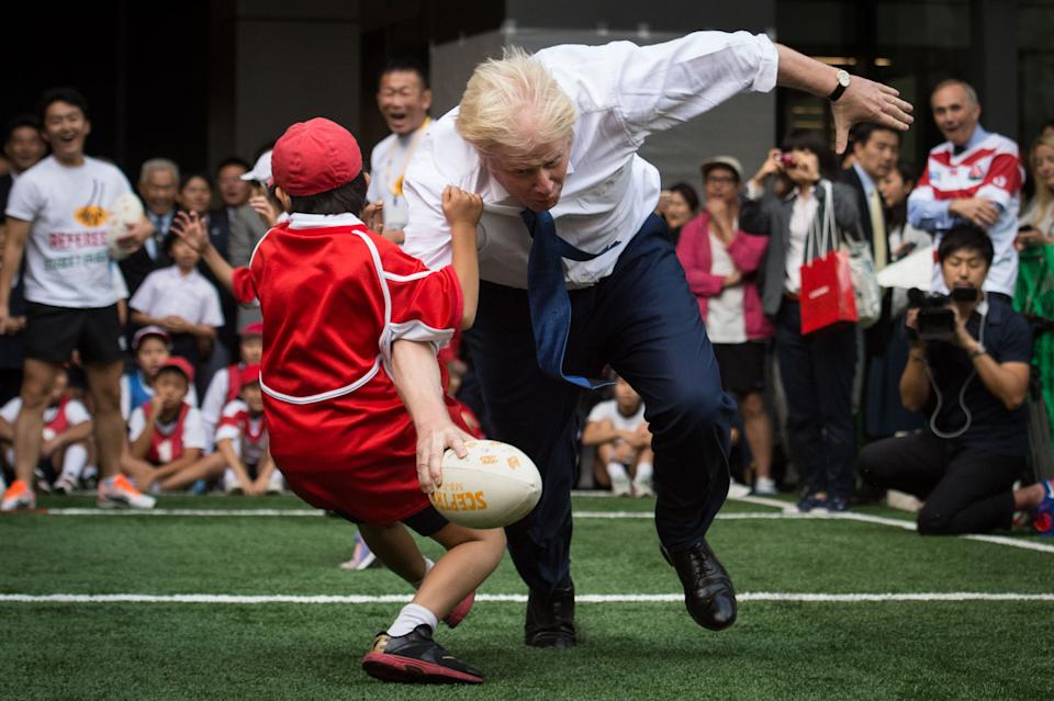 Mayor of London Boris Johnson joins a Street Rugby tournament in a Tokyo street with school children and adults from Nihonbashi, Yaesu & Kyobashi Community Associations, to mark Japan hosting 2019 Rugby World Cup where Mr Johnson is on the final day of his four day trade visit to Japan.