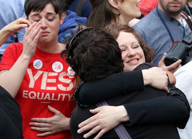 Emotions ran high as the landslide referendum result on same-sex marriage was announced in Dublin on May 23, 2015 (AFP Photo/Paul Faith)