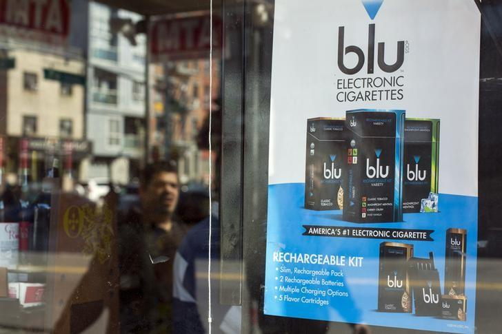A man walks past an advertisement for e-cigarettes in New York