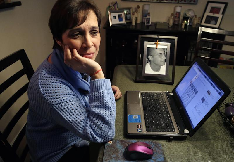 In this Monday, March 17, 2014 photo, Patty DiRenzo pauses as she uses a computer at her home in Blackwood, N.J., to look online for people seeking help for drug addiction. Her son, Salvatore Marchese, was found dead of a heroin overdose in her car, a needle and a bag of heroin on the center console. (AP Photo/Mel Evans)