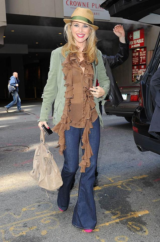 """What's the worst part of Christie Brinkley's getup? Her outdated fedora, her tentacle-adorned top, or her misuse of makeup? Ron Asadorian/<a href=""""http://www.splashnewsonline.com"""" target=""""new"""">Splash News</a> - April 17, 2011"""
